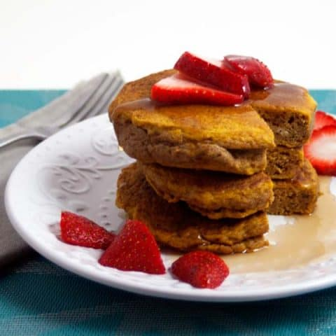 Stack of 3 pumpkin spice pancakes with strawberries