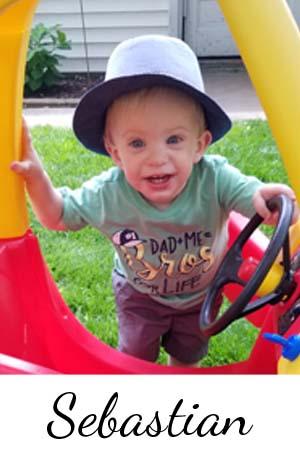 Little boy in toy car