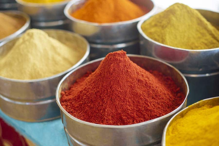 Assorted bright Moroccan spices, colorful background