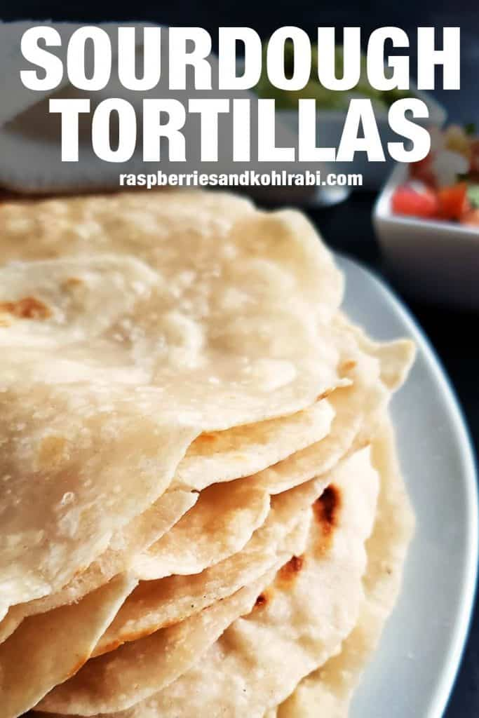 close up of flour tortillas stacked on a white plate