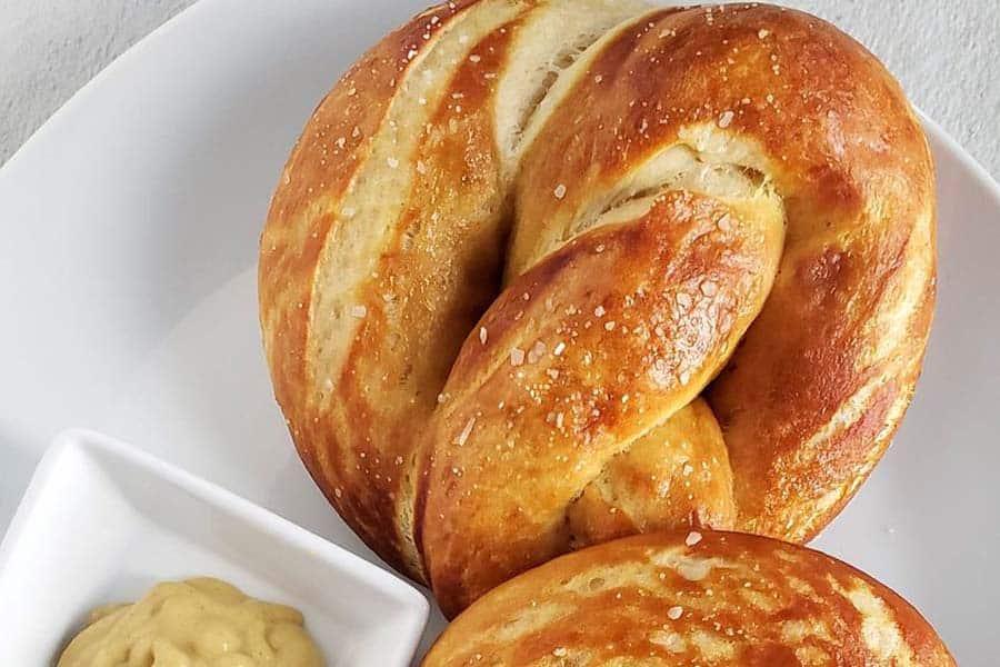 close up of homemade pretzel on a white plate