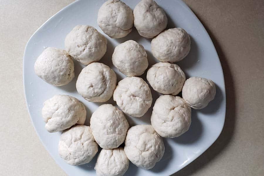 sourdough flour tortilla dough rolled into balls
