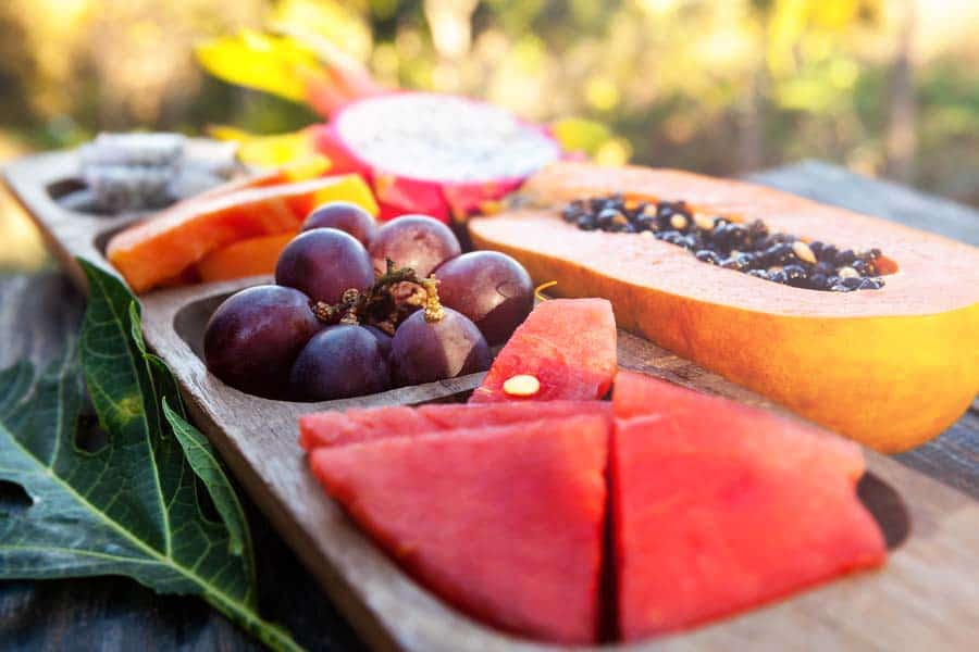 Delicious healthy tropical fruit breakfast on wooden table.