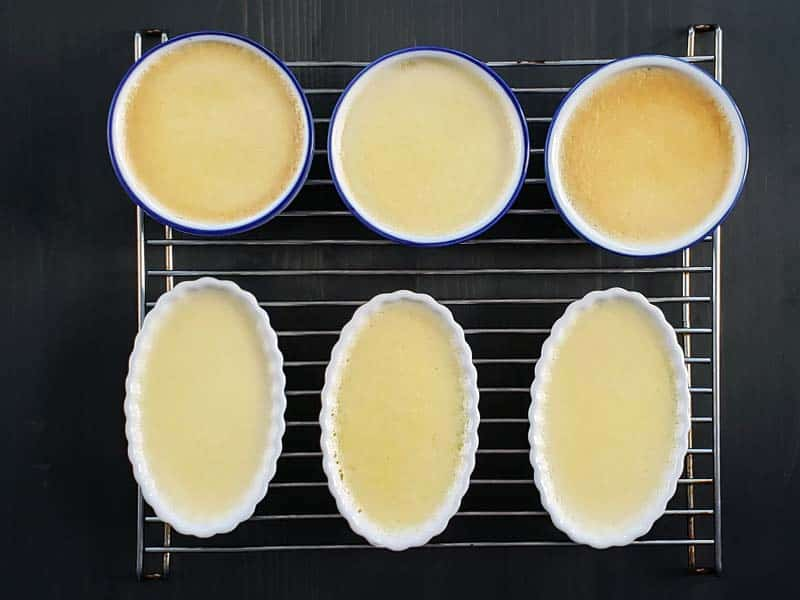 cooked creme brulee on cooling rack