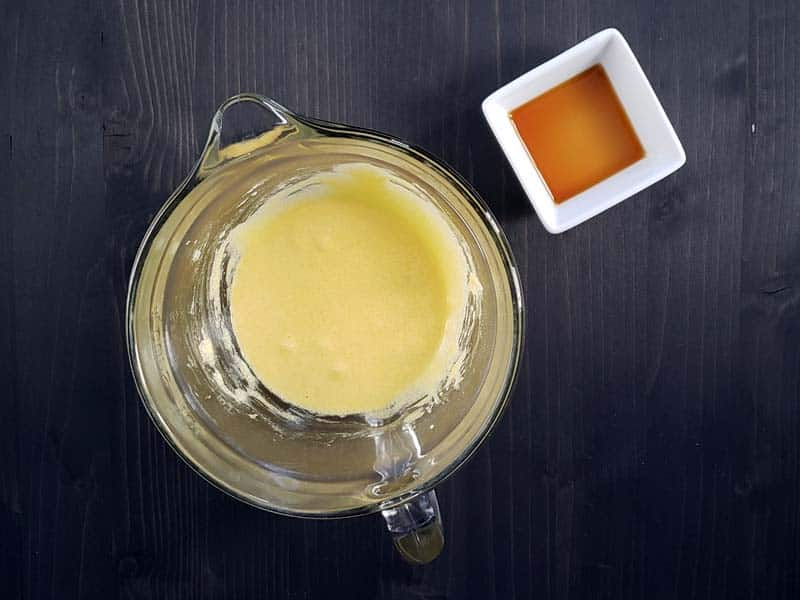 egg yolks whisked with sugar in a glass measuring cup