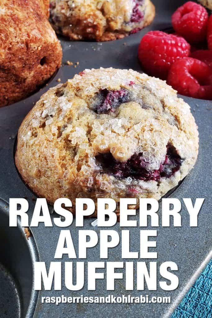 close up of a raspberry apple muffin in a muffin tin