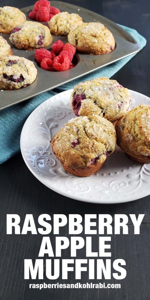three raspberry and apple muffins on a white plate
