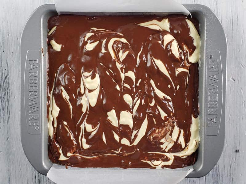 brownie and cheesecake layers swirled together
