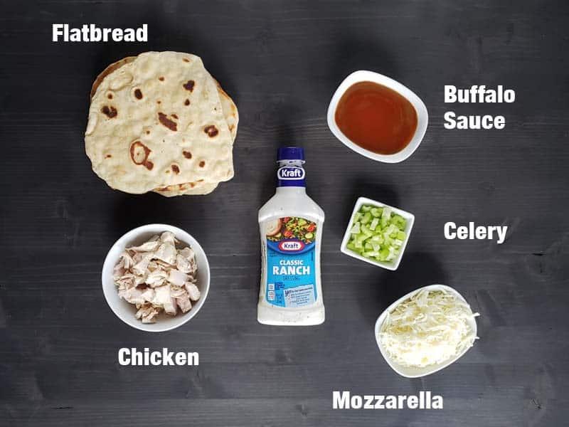 buffalo chicken flatbread ingredients on a dark background