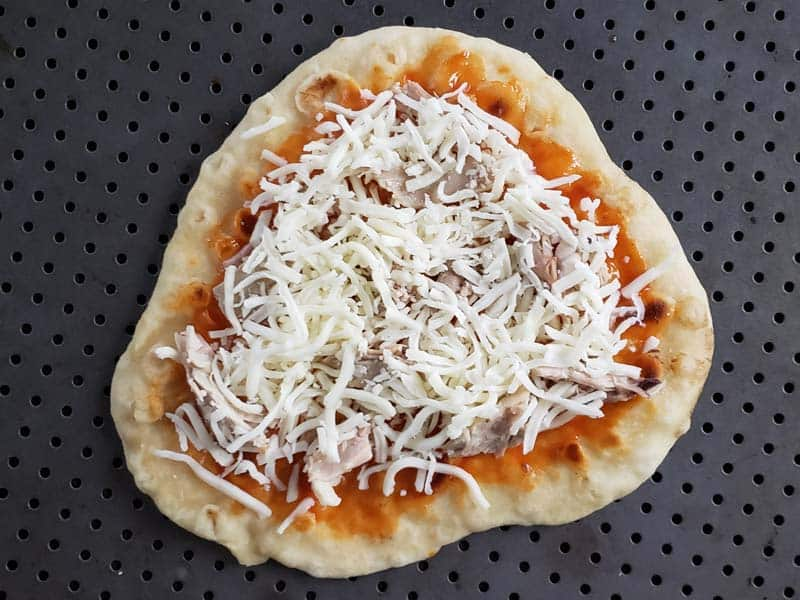 flatbread topped with chicken and cheese