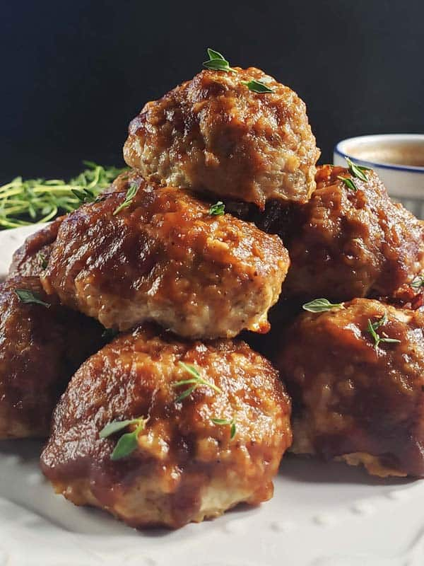 stack of chicken apple meatballs on a white plate