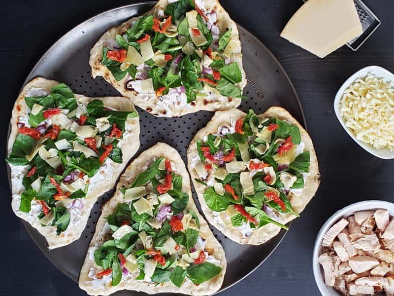 flatbread topped with chicken artichoke ingredients