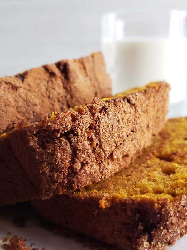 slices of sourdough pumpkin bread leaning on top of each other