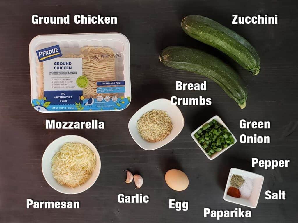 chicken zucchini fritter ingredients on a dark background