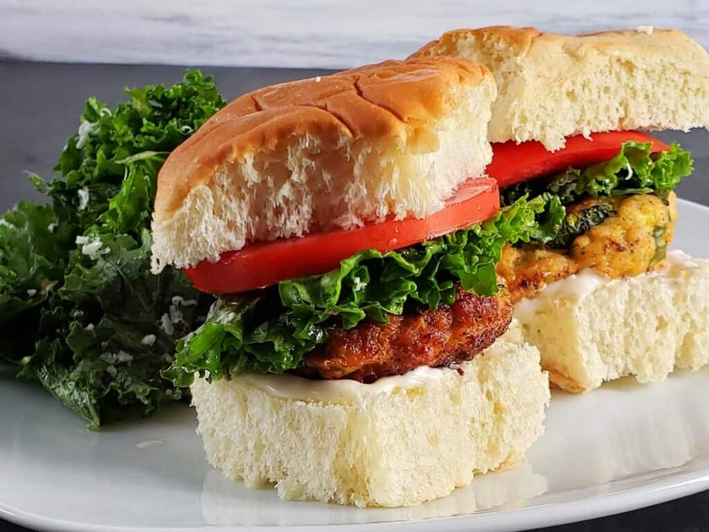 chicken zucchini patties on a bun with lettuce and tomato