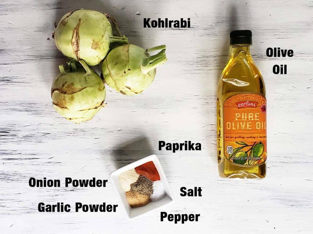 Kohlrabi fries ingredients on a white wood background