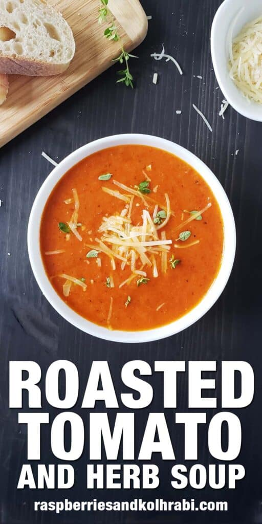 white bowl of tomato soup on a dark background