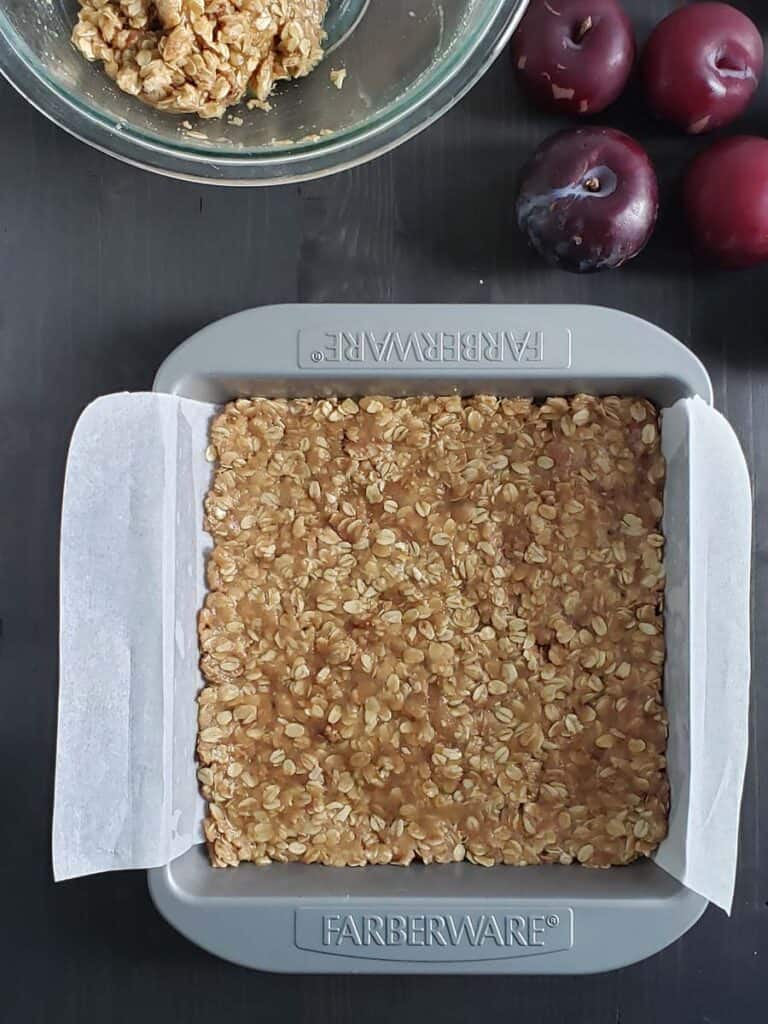 unbaked oatmeal sugar and butter in a metal pan