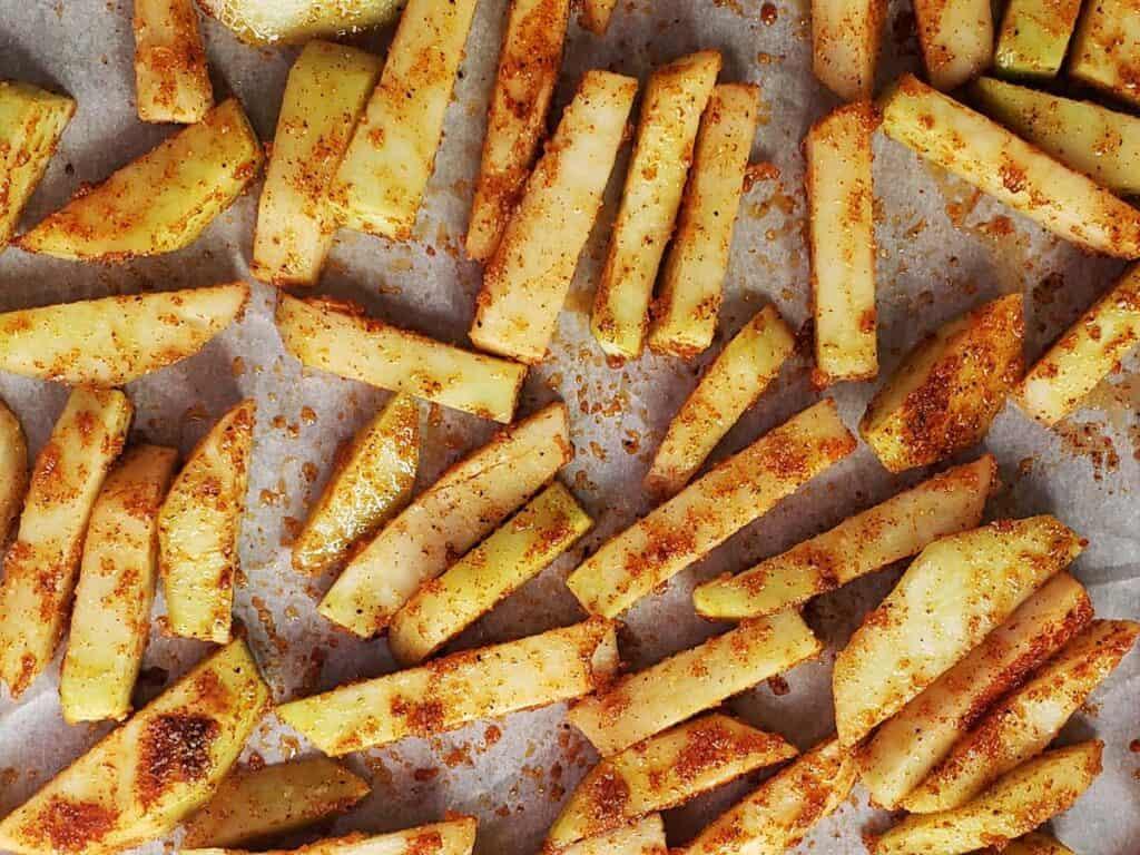 unbaked kohlrabi fries on a baking sheet