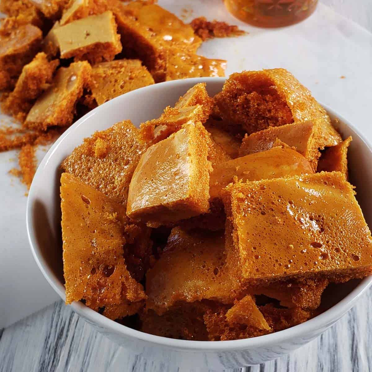 honeycomb candy piled in a white bowl