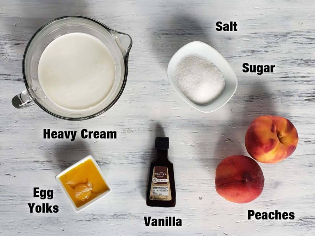 peach creme brulee ingredients on a white wood surface