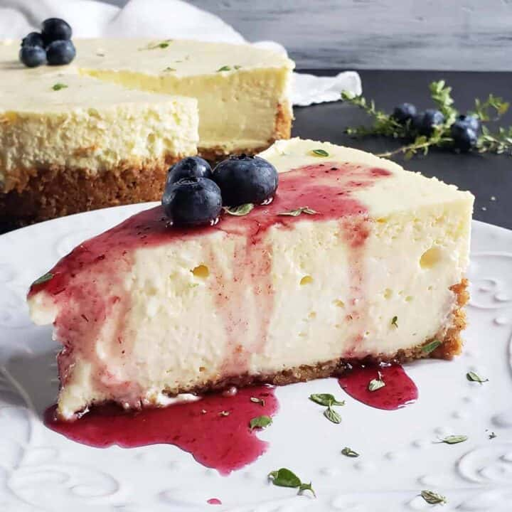 slice of lemon thyme cheesecake on a white plate