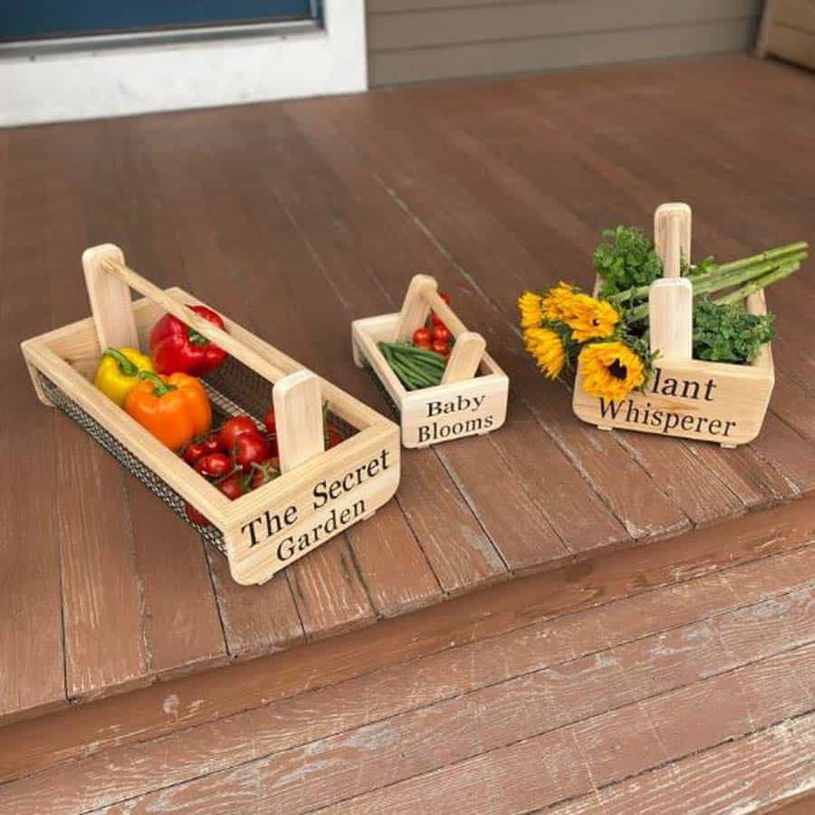 three wooden garden baskets filled with produce