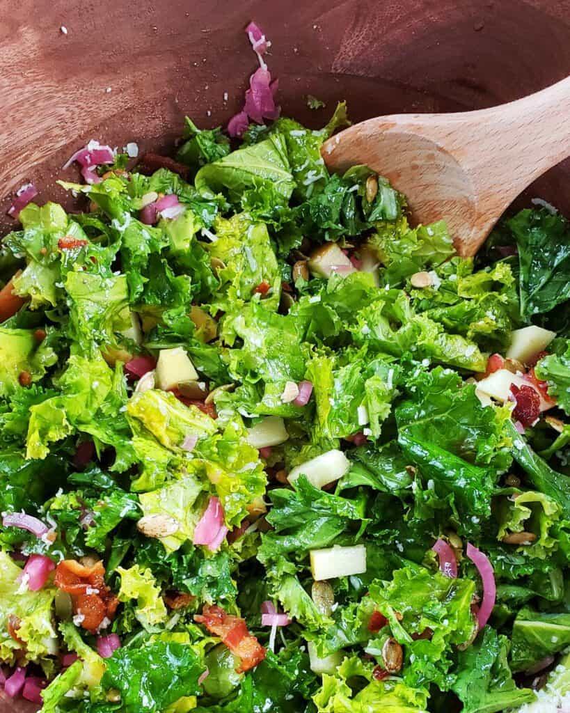 kale salad in wooden bowl