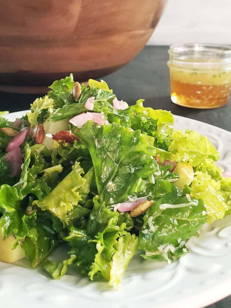 kale salad on a white plate