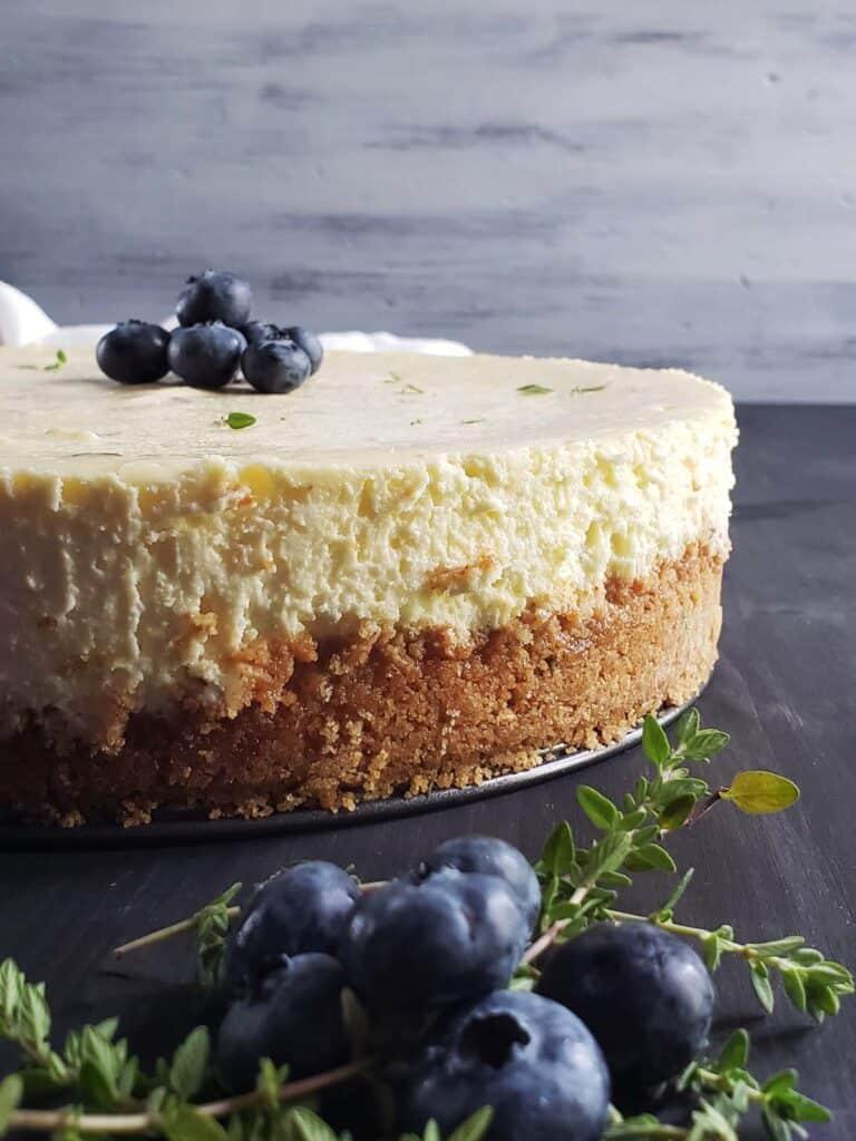 lemon thyme cheesecake on a dark surface