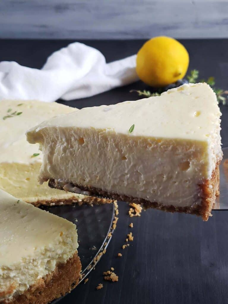 slice on lemon thyme cheese cake being lifted