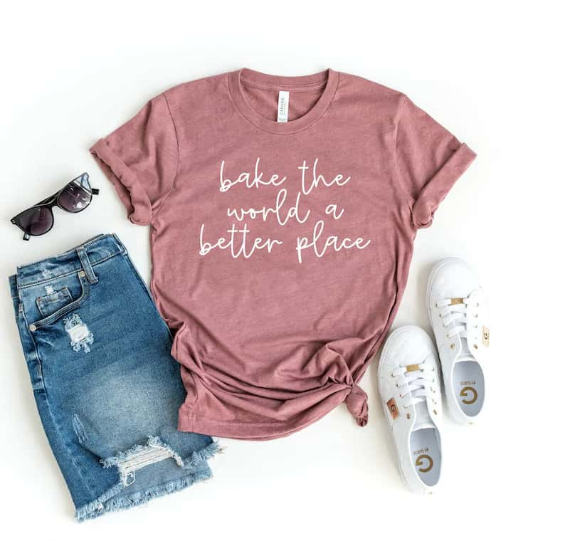 pink tshirt that says bake the world a better place