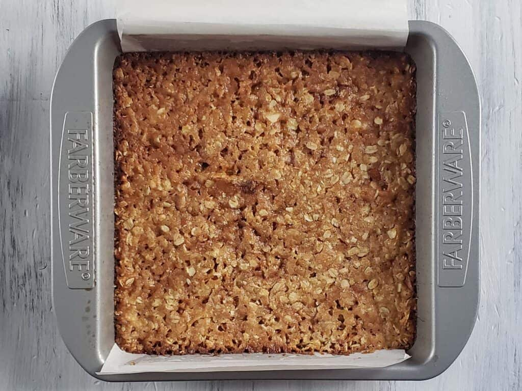 baked oatmeal crust in a metal pan