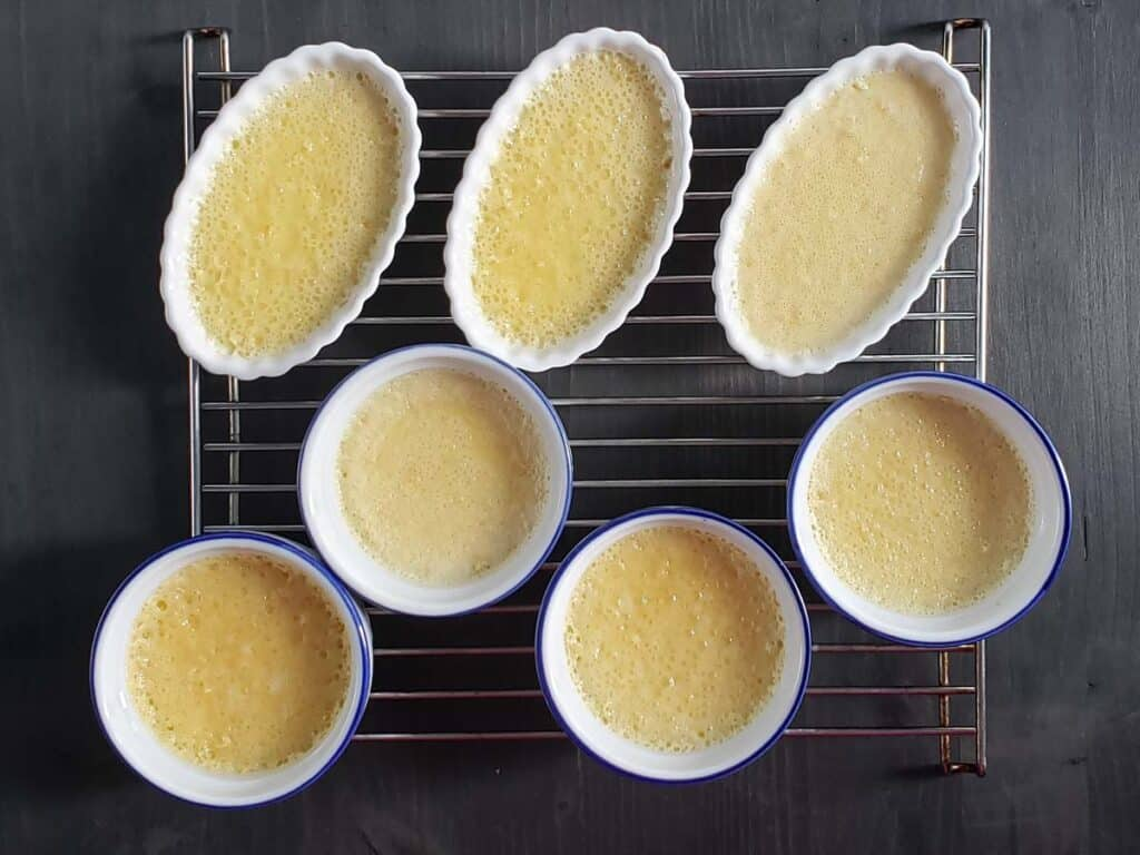 cooked creme brulees on a wire rack