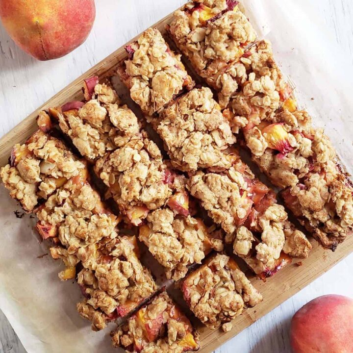 close up of peach bars on a white surface