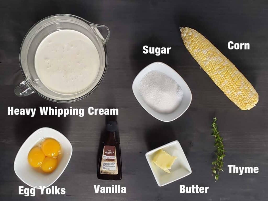 sweet corn creme brulee ingredients on a dark background