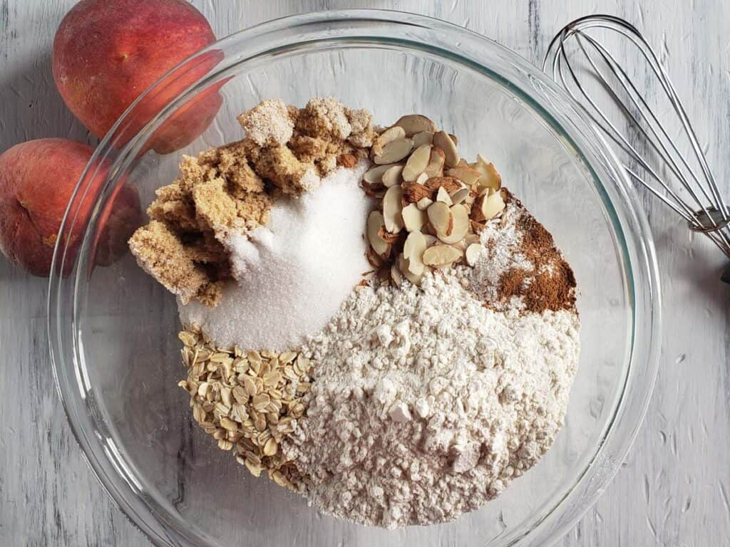 peach bar dry ingredients in a glass bowl
