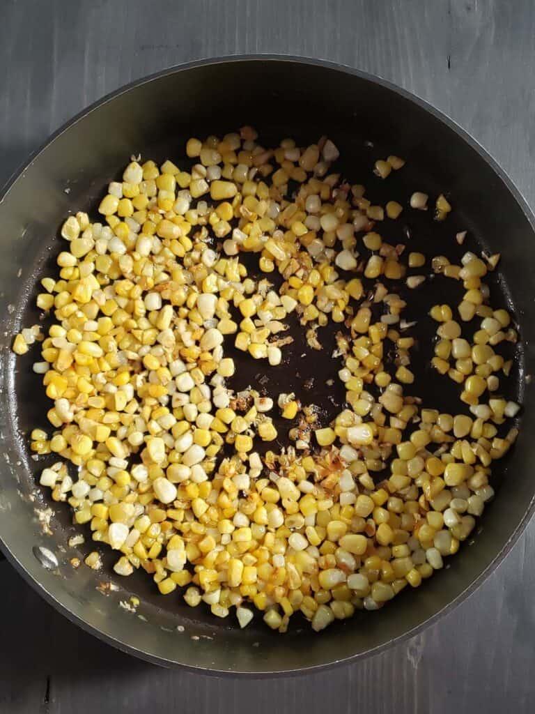 sauteed corn in sauce pan