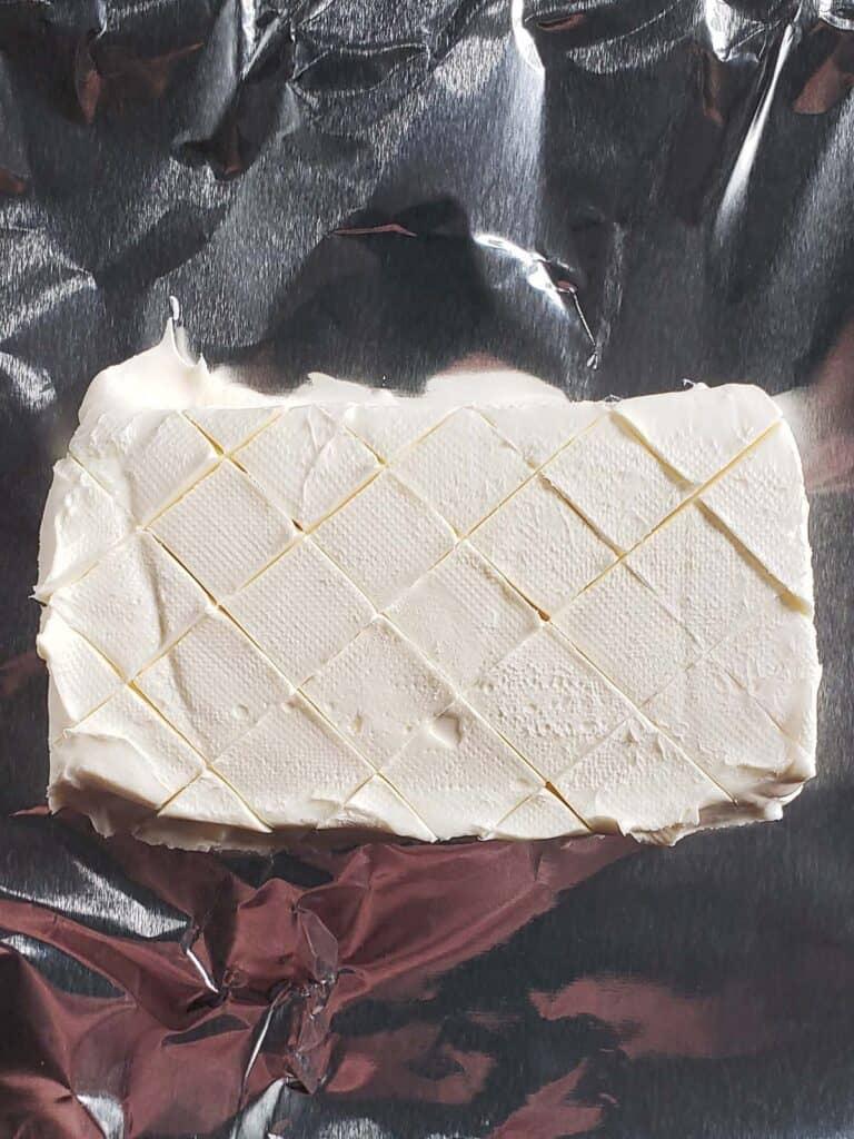 plain block of cream cheese on aluminum foil