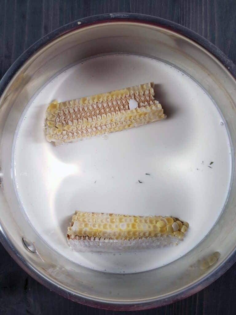 corn cob simmering in cream