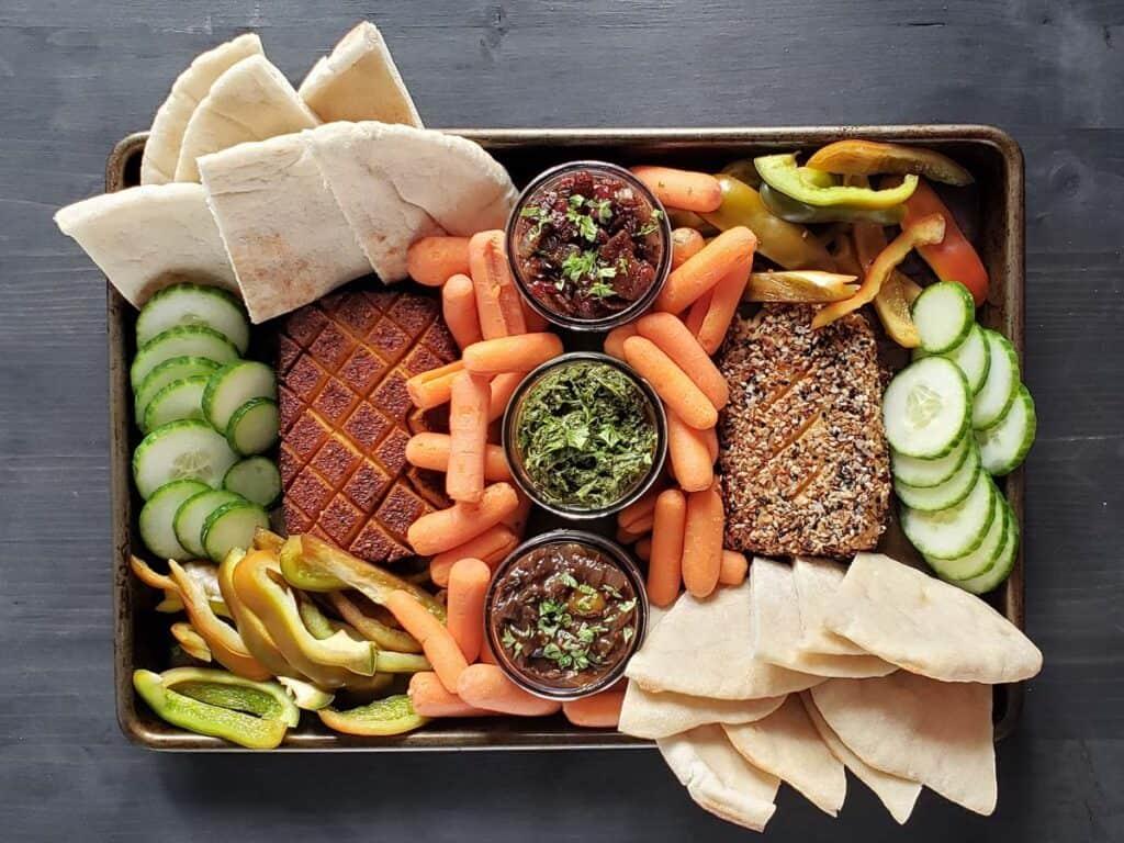 smoked cream cheese and veggies on a sheet pan