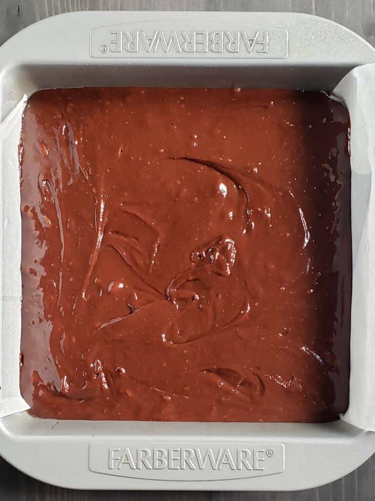 brownie batter in a baking pan