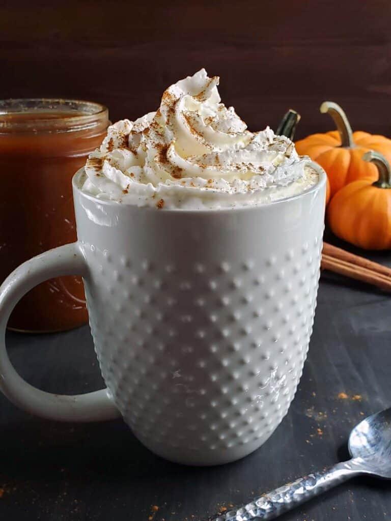 pumpkin latte in a white mug